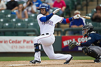 Round Rock Express designated hitter Robinson Chirinos #14 follows through on his swing against the New Orleans Zephyrs in the Pacific Coast League baseball game on April 21, 2013 at the Dell Diamond in Round Rock, Texas. Round Rock defeated New Orleans 7-1. (Andrew Woolley/Four Seam Images).