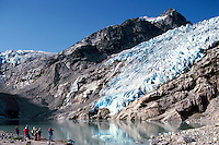 Bugaboo Provincial Park, BC, British Columbia, Canada - Hikers hiking at Vowell Glacier and Ice Lake, in Alpine Region of Purcell Mountains