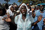 A woman prays during a Catholic mass in Port-au-Prince marking the one-year anniversary of the January 12, 2010, earthquake that devastated Haiti. Held in the shadows of the ruins of the city's Catholic cathedral, the gathering was one of many special observances held throughout the Caribbean nation...