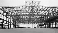 The steel frame of one of the units of the great aluminum development at Arvida - Que, <br /> <br /> 1926<br /> <br /> PHOTO : Toronto Star Archives - AQP