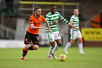 22nd August 2020; Tannadice Park, Dundee, Scotland; Scottish Premiership Football, Dundee United versus Celtic; Nicky Clark of Dundee United takes on Olivier Ntcham of Celtic