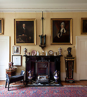 General Tam's Russian boots (perched on a Boulle plinth) and broad-sword above the fireplace in the dining room. His Russian stool stands to the left, beneath a portrait of scholar Sir John Dalyell, who taught Charles Darwin natural history