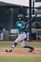 AZL Mariners shortstop Cesar Izturis Jr (3) follows through on his swing during an Arizona League game against the AZL White Sox at Camelback Ranch on July 8, 2018 in Glendale, Arizona. The AZL White Sox defeated the AZL Mariners 8-5. (Zachary Lucy/Four Seam Images)