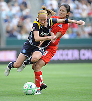 Los Angeles Sol (22) Manya Makoski pushes Washington Freedom Homare Sawa away at the Home Depot Center in Carson, CA on Sunday, March 29, 2009..