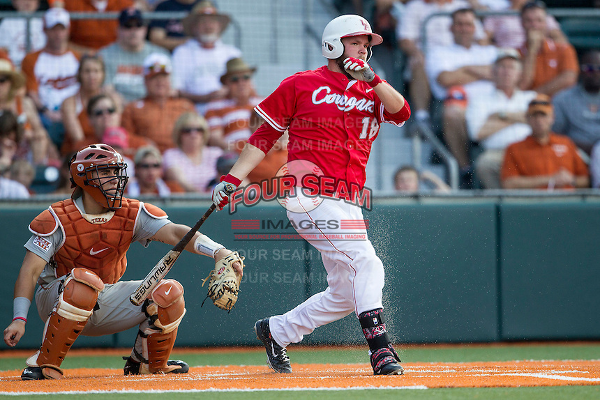 Houston Cougars first baseman Casey Grayson (18) follows through on his swing during the NCAA baseball game against the Texas Longhorns on June 6, 2014 at UFCU Disch–Falk Field in Austin, Texas. The Longhorns defeated the Cougars 4-2 in Game 1 of the NCAA Super Regional. (Andrew Woolley/Four Seam Images)