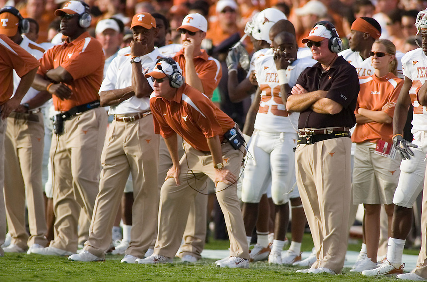 07 October 2006: Texas head coach Mack Brown, hands on knees, watches his team from the sidelines during the Longhorns 28-10 victory over the University of Oklahoma Sooners at the Cotton Bowl in Dallas, TX.