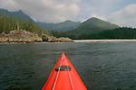 Wilderness beach, Kayak bow, Vancouver Island, Sea kayaker paddling Brooks Peninsula, Checleset Bay Ecological Preserve, British Columbia, Canada, Mariner II by Mariner Kayaks.