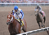 Wildcat Nation wins the seventh race at Saratoga on Aug. 26, 2009 for jockey Cornelio Velasquez and trainer D. Wayne Lukas.
