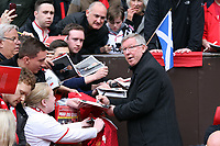 Pictured: Sir Alex Ferguson, manager for Manchester City signing autographs before kick off. Sunday 12 May 2013<br /> Re: Barclay's Premier League, Manchester City FC v Swansea City FC at the Old Trafford Stadium, Manchester.