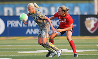 Philadelphia midfielder, Caroline Seger (9) traps the ball while Atlanta defender,Stacy Bishop (4) marks from behind.  Atlanta and Philadelphia played to a 0-0 draw in the season opener for both teams at John A Farrell Stadium in West Chester, PA.