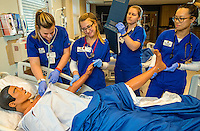 On-location photography of the students training in hospital like classrooms at the Presbyterian School of Nursing at Queens University of Charlotte. The  healthcare/patient simulation labs allow the students a hands on training experience in hospital room like setting.<br /> <br /> Charlotte Photographer - PatrickSchneiderPhoto.com
