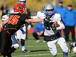 Pahranagat Valley's Ike Taylor runs from Whittell's Connor Huber during the first half of the NIAA DIV championship game against Whittell High at Dayton High School in Dayton, Nev., on Saturday, Nov. 21, 2015. (Cathleen Allison/Las Vegas Review Journal)