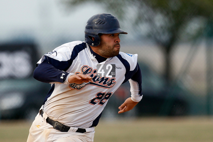 14 July 2011: Catcher Vincent Ferreira of the Savigny Lions runs during the 2011 Challenge de France match won 7-2 by the Savigny Lions over the PUC, in Les Andelys, near Rouen, France.