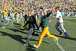 North Dakota State Bison fans storm the field after the FCS Championship game between the North Dakota State Bison and the Sam Houston State Bearkats at the FC Dallas Stadium in Frisco, Texas. North Dakota defeats Sam Houston 39 to 13..