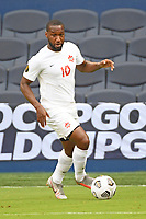 KANSASCITY, KS - JULY 11: Junior Hoilett #10 of Canada with the ball during a game between Canada and Martinique at Children's Mercy Park on July 11, 2021 in KansasCity, Kansas.