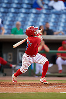 Clearwater Threshers shortstop Grenny Cumana (12) follows through on a swing during a game against the Palm Beach Cardinals on April 14, 2017 at Spectrum Field in Clearwater, Florida.  Clearwater defeated Palm Beach 6-2.  (Mike Janes/Four Seam Images)