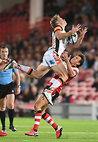 24th September 2021;  Kingsholm Stadium, Gloucester, England; Gallaher Premiership Rugby, Gloucester Rugby versus Leicester Tigers: Lloyd Evans of Gloucester tackles Harry Potter of Leicester Tigers in the air