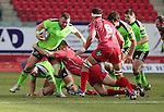 Scarlets hooker Ken Owens tackles Munster prop Stephen Archer.<br /> Guiness Pro12<br /> Scarlets v Munster<br /> 21.02.15<br /> ©Steve Pope -SPORTINGWALES