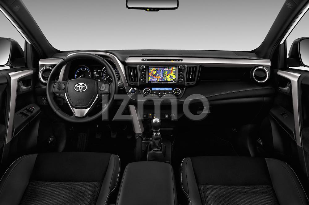 Stock photo of straight dashboard view of 2016 Toyota RAV4 Style 5 Door SUV Dashboard