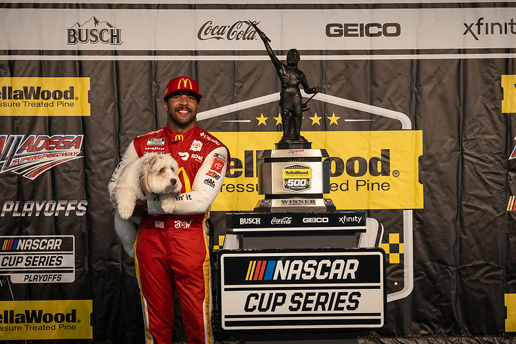 #23: Bubba Wallace, 23XI Racing, Toyota Camry McDonald's in victory lane with dog Asher