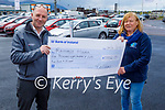 Tim Kelliher of Kellihers Toyota present a cheque for €5,852.51 to Kathleen Collins of Recovery Haven from their recent Shave and Dye fundraiser.