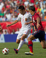 Spain forward David Villa (7) dribbles as USA defender   Eric Lichaj (14) closes. In a friendly match, Spain defeated USA, 4-0, at Gillette Stadium on June 4, 2011.