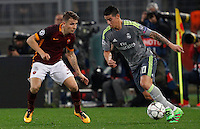 Calcio, andata degli ottavi di finale di Champions League: Roma vs Real Madrid. Roma, stadio Olimpico, 17 febbraio 2016.<br /> Real Madrid's James Rodriguez, right, is challenged by Roma's Lucas Digne during the first leg round of 16 Champions League football match between Roma and Real Madrid, at Rome's Olympic stadium, 17 February 2016.<br /> UPDATE IMAGES PRESS/Riccardo De Luca