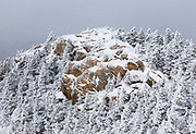 The summit of Mount Liberty during the winter months in Lincoln, New Hampshire USA, which is part of the White Mountains.