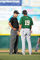 Savannah Sand Gnats manager Jose Leger (19) argues a call with base umpire Reid Joyner during the game against the Hickory Crawdads at L.P. Frans Stadium on June 14, 2015 in Hickory, North Carolina.  The Crawdads defeated the Sand Gnats 8-1.  (Brian Westerholt/Four Seam Images)
