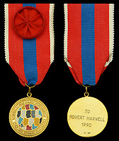 BNPS.co.uk (01202 558833)<br /> Pic: DixNoonanWebb/BNPS<br /> <br /> Pictured: Together for Peace Foundation medal.<br /> <br /> The bravery medals awarded to disgraced media tycoon Robert Maxwell for his wartime heroics have today sold for £7,500.<br /> <br /> Decades before the fraudster stole millions of pounds from the pension fund of Mirror Group Newspapers and then drowned in mysterious circumstances, Maxwell was a decorated war hero with a tragic past.<br /> <br /> Maxwell took part in the Normandy invasion and fought across Europe towards Germany. In April 1945 he was awarded the Military Cross for storming a German machine-gun post that had been pinning down British soldiers on the Holland/German border.<br /> <br /> His medals went under the hammer with London auctioneers Dix Noonan Webb.