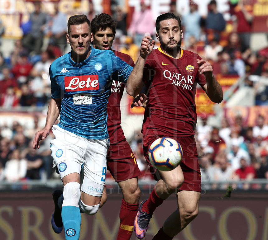 Football, Serie A: AS Roma - SSC Napoli, Olympic stadium, Rome, March 31, 2019. <br /> Napoli's Arkadiusz Milik (l) in action with Roma's Kostas Manolas (r) during the Italian Serie A football match between Roma and Napoli at Olympic stadium in Rome, on March 31, 2019.<br /> UPDATE IMAGES PRESS/Isabella Bonotto