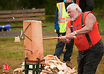 HARWINTON, CT--- -100215JS02---Chip Arthur of South Gibson, Penn., competes in the standing block axe cutting competiton during the 159th annual Harwinton Fair Saturday at the Harwinton Fairground. Arthur, at the age of 70, was the oldest person competing in the events. The fair continues through today from 8:00 a.m .to 5:00 p.m.<br /> Jim Shannon Republican-American