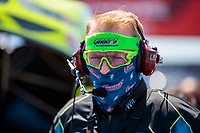 Aug 8, 2020; Clermont, Indiana, USA; A crew member for NHRA funny car driver Tim Wilkerson (not pictured) wears a face mask covering during qualifying for the Indy Nationals at Lucas Oil Raceway. Mandatory Credit: Mark J. Rebilas-USA TODAY Sports