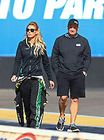 Feb 3, 2016; Chandler, AZ, USA; NHRA top fuel driver Leah Pritchett (left) with team owner Bob Vandergriff Jr during pre season testing at Wild Horse Pass Motorsports Park. Mandatory Credit: Mark J. Rebilas-USA TODAY Sports