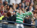 Kieran Tierney receives the cup on the podium