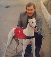 BNPS.co.uk (01202) 558833. <br /> Pic: TaylorFamily/BNPS<br /> <br /> With Video - https://we.tl/t-b8hueJpc4M<br /> <br /> Pictured: Jack Taylor with his greyhound. <br /> <br /> A stopwatch used by English football referee Jack Taylor to time the 1974 World Cup final is going under the hammer.<br /> <br /> The piece of football history assisted Taylor when awarding two penalties in the first 30 minutes of the match – including the fastest ever given in a World Cup final.<br /> <br /> The Omega watch is being sold by Taylor's family for an estimated £5,000 at auctioneers Fellows of Birmingham.