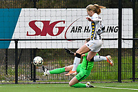 goalkeeper Josephine Delvaux (1) of KRC Genk tries to block the attempt of Ludmila Matavkova (9) of Sporting Charleroi during a female soccer game between Sporting Charleroi and KRC Genk on the 4 th matchday in play off 2 of the 2020 - 2021 season of Belgian Scooore Womens Super League , friday 30 th of April 2021  in Marcinelle , Belgium . PHOTO SPORTPIX.BE | SPP | Jill Delsaux