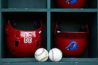Clearwater Threshers helmets and baseballs in the dugout before a game against the Dunedin Blue Jays on April 8, 2016 at Bright House Field in Clearwater, Florida.  Dunedin defeated Clearwater 8-3.  (Mike Janes/Four Seam Images)