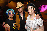 """Meryl Cohen, Tom Robinson and Natalie Skipworth at the Planned Parenthood's """"Party Like a Rock Star"""" benefit at Warehouse Live Saturday Aug. 22, 2009.(Dave Rossman/For the Chronicle)"""