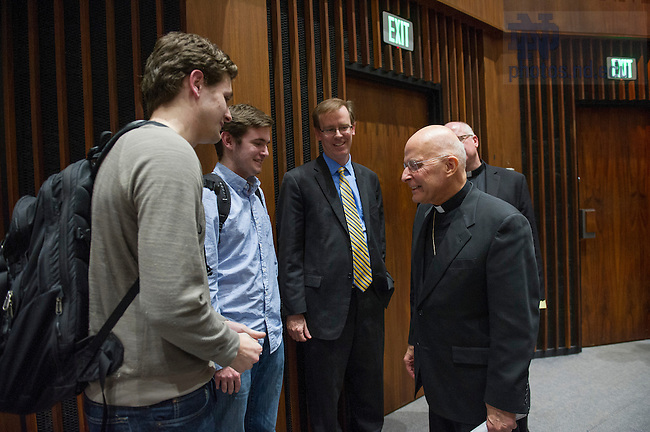 """Mar.6, 2014; Cardinal Francis George, Archbishop of Chicago, talks with students after his lecture titled, """"Mercy in the Teaching and Ministry of Pope Francis"""" in the auditorium of McKenna Hall. Photo by Barbara Johnston/University of Notre Dame"""