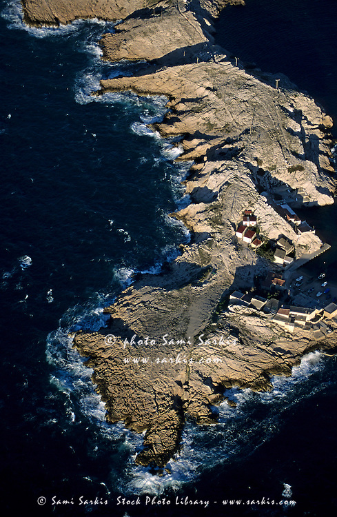 Rocky inlet surrounded by sea, Cape Croisette, Marseille, France.