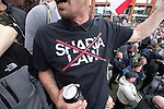 """© Joel Goodman - 07973 332324 . 11/06/2017 . Manchester , UK . A demonstrator wearing a No Sharia Law t-shirt . Demonstration against Islamic hate , organised by former EDL leader Tommy Robinson's """" UK Against Hate """" and opposed by a counter demonstration of anti-fascist groups . UK Against Hate say their silent march from Piccadilly Train Station to a rally in Piccadilly Gardens in central Manchester is in response to a terrorist attack at an Ariana Grande concert in Manchester , and is on the anniversary of the gun massacre at the Pulse nightclub in Orlando . Photo credit : Joel Goodman"""