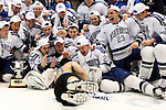 A fan jumps into the Air Force team photograph after winning the championship game 4-0 against RIT at Blue Cross Arena in Rochester, New York on March 17, 2012.
