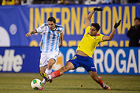 Ecuador midfielder Christian Noboa (6) goes for a tackle on Argentina midfielder Angel Di Maria (7) during the first half of an international friendly between the men's national teams of Argentina and Ecuador at MetLife Stadium in East Rutherford, NJ, on November 15, 2013.