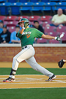 Harold Martinez #9 of the Miami Hurricanes follows through on his swing against the Wake Forest Demon Deacons at Gene Hooks Field on March 18, 2011 in Winston-Salem, North Carolina.  Photo by Brian Westerholt / Four Seam Images