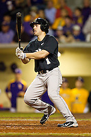Steven Brooks #1 of the Wake Forest Demon Deacons follows through on his swing against the LSU Tigers at Alex Box Stadium on February 18, 2011 in Baton Rouge, Louisiana.  The Tigers defeated the Demon Deacons 15-4.  Photo by Brian Westerholt / Four Seam Images
