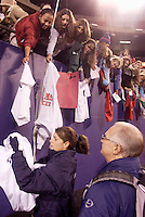 """Mia Hamm signs autographs after the game. The US Women's National Team tied the Denmark Women's National Team 1 to 1 during game 8 of the 10 game the """"Fan Celebration Tour"""" at Giant's Stadium, East Rutherford, NJ, on Wednesday, November 3, 2004.."""