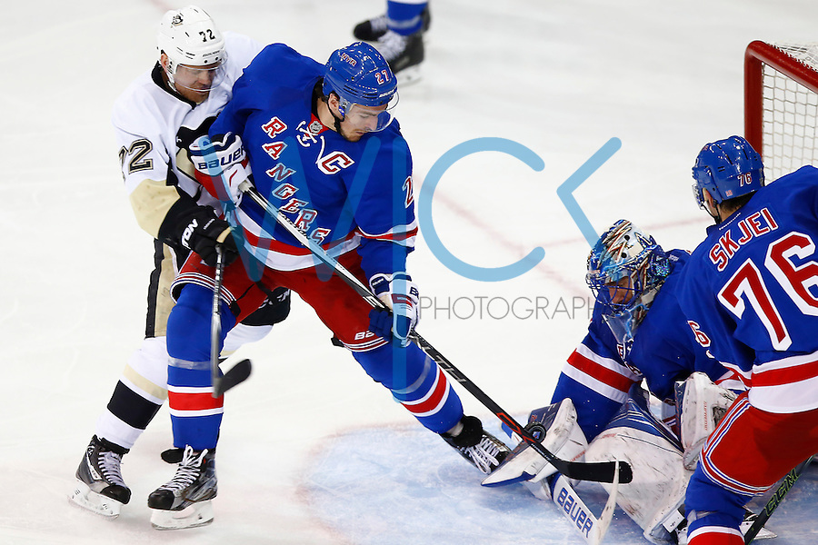 Patric Hornqvist #72 of the Pittsburgh Penguins reaches for the puck around Ryan McDonagh #27 of the New York Rangers in front of Henrik Lundqvist #30 in the second period during game four of the first round of the Stanley Cup Playoffs at Madison Square Garden in New York City on April 21, 2016. (Photo by Jared Wickerham / DKPS)