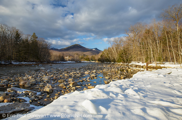 East Branch of the Pemigewasset River in Lincoln, New Hampshire covered in snow during the spring months. Big Coolidge Mountain is off in the distance. This mountain was logged during the East Branch & Lincoln Railroad era (1893-1948).