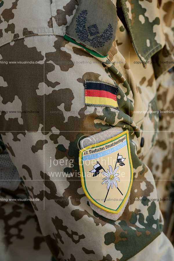 MALI, Gao, Minusma UN peace keeping mission, Camp Castor, german army Bundeswehr , camouflage uniform with german flag and UNITED NATIONS Minusma, United Nations Multidimensional Integrated Stabilization Mission in Mali, german troop contingent sticker